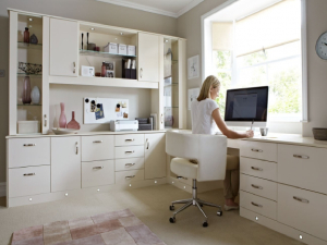 Clean office with lady working by window  - Tips for Creating your Home Office part 2 of 2- Fort Myers - Richardson Custom Homes