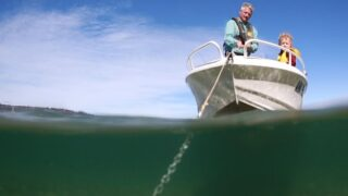 man anchoring - Boating tips - Fort Myers - Richardson Custom Homes