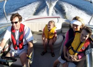 family on boat – Boating tips - Sanibel - Richardson Custom Homes