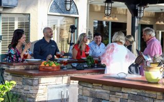 cooking with guests - outdoor kitchens - Fort Myers - Richardson Custom Homes