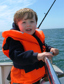 youth in life jacket – Boating tips - Fort Myers - Richardson Custom Homes