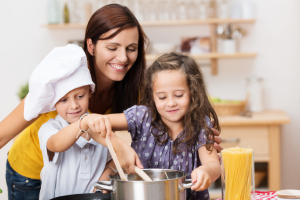 Mom and kids in kitchen – 5 Clues why the Kitchen is the heart of your home - Fort Myers - Richardson Custom Homes